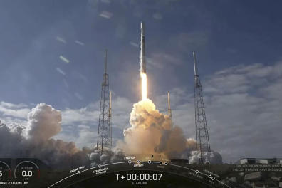 """This video still image provided by SpaceX shows a SpaceX Falcon 9 rocket as it lifts off to launch 60 new Starlink satellites into orbit from Cape Canaveral Air Force Station, Florida on February 17, 2020. - SpaceX successfully launched its latest cluster of high-speed internet satellites into orbit February 17, 2020 but was unable to land its rocket booster on an autonomous ship, missing a key milestone. The private company founded by billionaire Elon Musk has revolutionized spaceflight in recent years by developing rockets capable of delivering their payload in space then flying back to Earth and landing upright on a target zone, ready to be-reused.It has successfully landed its booster 49 times previously and Monday's mission would have been the 50th. (Photo by Handout / SPACEX / AFP) / RESTRICTED TO EDITORIAL USE - MANDATORY CREDIT """"AFP PHOTO /SPACEX/HANDOUT """" - NO MARKETING - NO ADVERTISING CAMPAIGNS - DISTRIBUTED AS A SERVICE TO CLIENTS"""