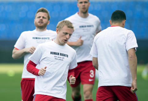 Norway's midfielder Mats Moller Daehli (2L) and teammates wear a t-shirt with the slogan 'Human rights, on and off the pitch' as they warm up before the FIFA World Cup Qatar 2022 qualification football match between Norway and Turkey at La Rosaleda stadium in Malaga on March 27, 2021. (Photo by JORGE GUERRERO / AFP)