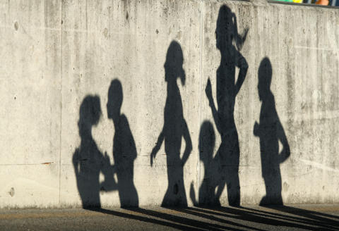 The shadows of competitors are seen during the athletics women's marathon final during the 2018 Gold Coast Commonwealth Games at the Southport Broadwater Parklands venue on the Gold Coast on April 15, 2018. (Photo by Adrian DENNIS / AFP)
