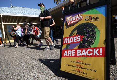 VALLEJO, CALIFORNIA - APRIL 01: People enter Six Flags Discovery Kingdom on April 01, 2021 in Vallejo, California. Six Flags Discovery Kingdom reopened its doors to members today with limited park capacity and a select few rides in operation. The park will open to the general public on Saturday April 3. Justin Sullivan/Getty Images/AFP == FOR NEWSPAPERS, INTERNET, TELCOS & TELEVISION USE ONLY ==