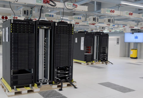 This picture taken on September 19, 2019 in Angers, shows the global High Performance Computing (HPC) Test Lab, during the inauguration at the Atos' site. (Photo by ERIC PIERMONT / AFP)