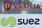 Les logos des entreprises françaises Veolia et Suez.
