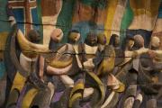 Face à la sortie de l'ancien aéroport de Tbilissi, une fresque en hommage au voyage, sculptée pendant la période soviétique.