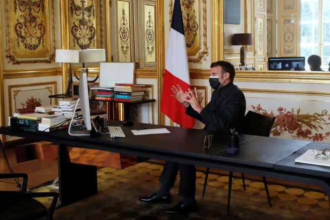 French President Emmanuel Macron speaks with a school principal, teachers and children from the Itard school, located in Oraison, in the south of France, from the Elysee Palace, on April 6 in Paris.
