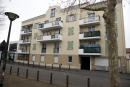 A picture taken on April 1, 2016 shows the building where lived main suspect in a foiled attack plot Reda Kriket. - French national Reda Kriket, 34, was arrested near Paris last week and a police raid on his apartment netted a cache of assault rifles, handguns and TATP, the highly volatile homemade explosive favoured by IS jihadists. The move comes as investigators stepped up efforts to smash a tangled web of Islamic State-linked extremists blamed for both the November Paris attacks and last week's suicide bombings on Brussels airport and metro that killed 32 people. (Photo by KENZO TRIBOUILLARD / AFP)