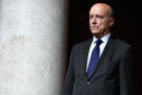 Former French Prime Minister Alain Juppe holds a moment of silence to pay tribute to former French president Jacques Chirac ahead of a session of questions to the government at the National Assembly (Assemblee Nationale) in Paris on October 1, 2019. - Former French President Jacques Chirac died on September 26, 2019 at the age of 86. (Photo by STEPHANE DE SAKUTIN / AFP)