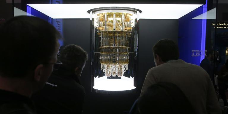 CES patrons take a look as IBM unveils this quantum computer, Q System One, shown here during the CES tech show Wednesday, Jan. 8, 2020, in Las Vegas. (AP Photo/Ross D. Franklin)