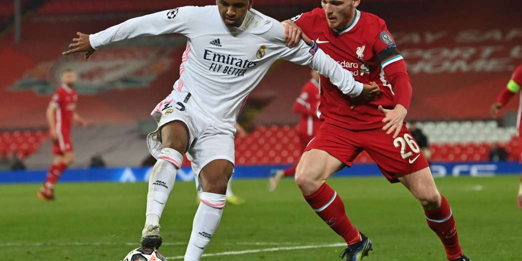 Real Madrid's Brazilian forward Rodrygo (L) vies with Liverpool's Scottish defender Andrew Robertson during the UEFA Champions League quarter final second leg football match between Liverpool and Real Madrid at Anfield in Liverpool, north west   on April 14, 2021.  / AFP / Paul ELLIS