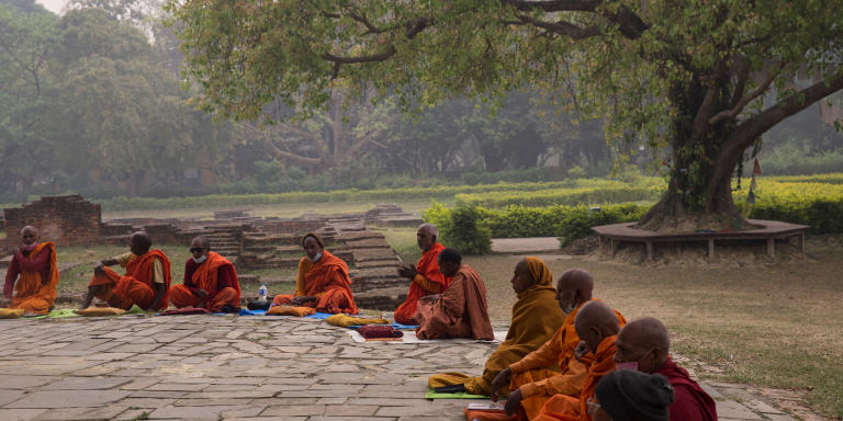 Buddhist monks praying and meditating as their morning rituals in front of Mayadevi temple, the birthplace of Lord Buddha in Lumbini, Rupandehi district of Lumbini Province in Nepal on April 5, 2021. Lumbini is one of the UNESCO World Heritage Sites.