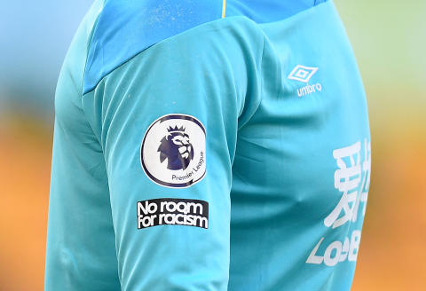 A 'No Room For Racism' logo is pictured on the shirt of Burnley's English goalkeeper Nick Pope during the English Premier League football match between Wolverhampton Wanderers and Burnley at the Molineux stadium in Wolverhampton, central England on April 25, 2021. RESTRICTED TO EDITORIAL USE. No use with unauthorized audio, video, data, fixture lists, club/league logos or 'live' services. Online in-match use limited to 120 images. An additional 40 images may be used in extra time. No video emulation. Social media in-match use limited to 120 images. An additional 40 images may be used in extra time. No use in betting publications, games or single club/league/player publications. / AFP / POOL / Oli SCARFF / RESTRICTED TO EDITORIAL USE. No use with unauthorized audio, video, data, fixture lists, club/league logos or 'live' services. Online in-match use limited to 120 images. An additional 40 images may be used in extra time. No video emulation. Social media in-match use limited to 120 images. An additional 40 images may be used in extra time. No use in betting publications, games or single club/league/player publications.