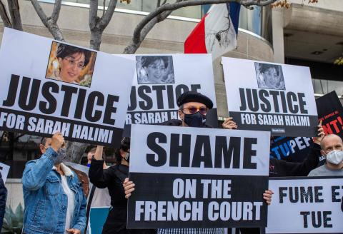 The Jewish community and the international Israel education organization StandWithUs holds a protest in front of the Consulate General of France on April 25, 2021 in Los Angeles, California to demand justice for Sarah Halimi. Sarah Halimi a 65-year-old French Jewish woman was killed by her neighbor in her Paris, France, apartment in April 2017. According to protest organizers Halimi was the victim of an anti Semitic attack. / AFP / Apu GOMES