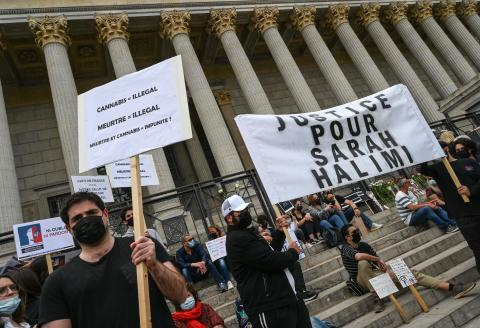 """People hold placards during a protest against the recent decision by France's highest court that murderer of Sarah Halimi was not criminally responsible, in Lyon, south-central France, on April 25, 2021. Halimi, a 65-year-old Orthodox Jewish woman, died in 2017 after being pushed out of the window of her Paris flat by neighbour Kobili Traore, 27, who shouted """"Allahu Akbar"""" (""""God is great"""" in Arabic). Traore, a heavy cannabis smoker, has been in psychiatric care since Halimi's death and he remains there after the ruling. / AFP / PHILIPPE DESMAZES"""