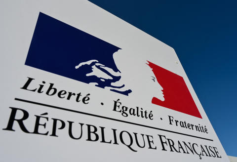 A logo (charte graphique) containing the Marianne, the 'Tricolore' with the colours of the French Republic and the national motto 'Liberty, Equality, Fraternity' (Liberte, Egalite, Fraternite) is seen on a sign of an administrative service near Lille, northern France, on September 17, 2019. (Photo by DENIS CHARLET / AFP)