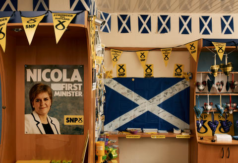 Various SNP campaign material including a poster of Scotland's First Minister Nicola Sturgeon and The Saltire Flag signed by various SNP members including the First Minister herself, photographed in the Cunningham South SNP office in Irvine, North Ayrshire, Scotland showing on Friday the 23rd of April 2021.