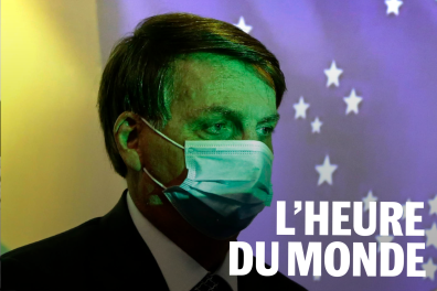 Brazil's President Jair Bolsonaro wears a protective face mask at the start of a ceremony where his nation's flag is projected in Brasilia, Brazil, Wednesday, Aug. 5, 2020. The Brazilian Supreme Court ordered Bolsonaro's administration Wednesday to adopt measures to shield Indigenous peoples from the new coronavirus, in a vote that came hours after a prominent Indigenous leader died from COVID-19.