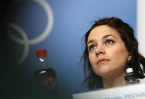 France's figure skater Nathalie Pechalat attends a press conference in Chekhov Hall at the Main Media Center in Sochi on February 5, 2014 ahead of the 2014 Sochi Winter Olympics. AFP PHOTO / LOIC VENANCE (Photo by LOIC VENANCE / AFP)