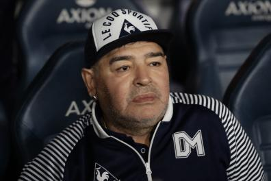 "(FILES) In this file photo taken on March 07, 2020 Argentine former football star Diego Maradona gestures during an homage before the start of the Argentina First Division 2020 Superliga Tournament football match Boca Juniors vs Gimnasia La Plata, at La Bombonera stadium, in Buenos Aires. Argentine football icon Diego Maradona received inadequate medical care and was left to his fate for a ""prolonged, agonizing period"" before he died last year, an expert medical panel concluded on April 30, 2021. / AFP / ALEJANDRO PAGNI"