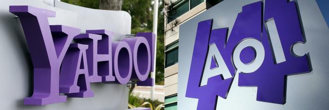 Combinaison d'images créée le 4 avril 2017 à partir du logo Yahoo affiché devant le siège social à Sunnyvale, en Californie, et le logo AOL affiché sur un panneau devant les bureaux d'AOL à Palo Alto, en Californie.
