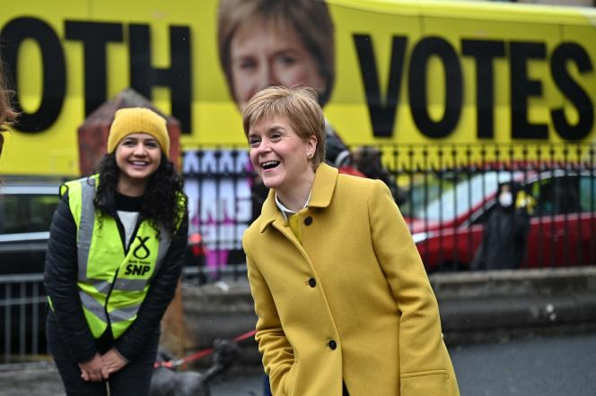 Scotland's First Minister Nicola Sturgeon (right) meets with voters outside a polling station in Glasgow, Scotland on 6 May 2021.
