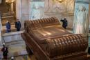 French President Emmanuel Macron and his wife Brigitte Macron stand in front of Napoleon's tomb during a ceremony to commemorate the 200th anniversary of Napoleon Bonaparte's death, at the Hotel des Invalides in Paris, France, May 5, 2021. Christophe Petit Tesson/Pool via REUTERS