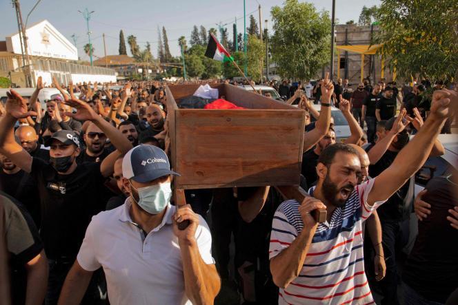 Les funérailles de Moussa Hassouna dans la ville de Lod (centre), le 11 mai 2021. Le Palestinien israélien a été tué par balle lors d'affrontements avec la sécurité israélienne à la suite d'une manifestation.