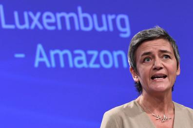 (FILES) In this file photo taken on October 4, 2017 EU Commissioner for Competition Margrethe Vestager gives a press conference, at the European Commission, in Brussels, and focused on two state aid cases, including the one ordering Amazon to repay Luxembourg 250 million euros in back taxes. Amazon wins over the EU court appeal on the Luxembourg tax case, on May 12, 2021. / AFP / EMMANUEL DUNAND