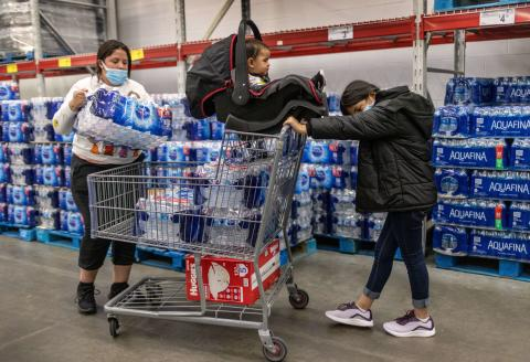 CLARKSVILLE, INDIANA - APRIL 25: Honduran immigrant Nani, 10, helps her aunt Saiyda Gonzalez shop at Sam's Club as her baby cousin looks on a day after the girl arrived to live with extended family on April 25, 2021 near Clarksville, Indiana. The unaccompanied minor had been released from U.S. Health and Human Services (HHS) custody after spending nearly eight weeks in shelters, the last one in New York City. Originally she had traveled with her mother from Honduras and crossed the Rio Grande from Mexico together, but they were immediately deported under Title 42 pandemic rules, according to the non-profit Every. Last. One, which facilitates reunifying children with families in the U.S. On March 1 Nanni's mother then sent the girl alone as an unaccompanied minor across the river with a smuggler, as such children are allowed entry into the U.S. under current Biden administration rules. As of April 21, HHS reports holding more than 21,000 children, most from Central America, in their custody pending placement with the their families or sponsors living in the U.S. Many of the minors, like Nani, had previously crossed the border with family members and been deported before being sent back across as unaccompanied minors by desperate parents. According to Gonzalez, Nani's mother remains in Mexico, hoping to again try and cross into the U.S. John Moore/Getty Images/AFP == FOR NEWSPAPERS, INTERNET, TELCOS & TELEVISION USE ONLY ==