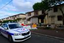 A police vehicle is parked outside the house where a 31-year-old French mother of three was burned alive by her husband, on May 5, 2021 in Merignac. The man chased her down the street and shot her in the legs before dousing her in a flammable liquid and setting her alight. He was arrested half an hour after the murder in the neighbouring district of Pessac, armed with a pistol, a pellet gun and a cartridge belt, the Bordeaux prosecutor's office said. / AFP / MEHDI FEDOUACH