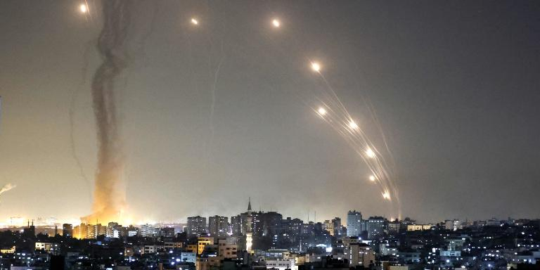 TOPSHOT - Rockets are launched towards Israel from Gaza City, controlled by the Palestinian Hamas movement, on May 11, 2021. / AFP / MAHMUD HAMS