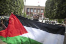 A protester waves a Palestinian flag during a protest in solidarity with Palestinians in Jerusalem, in Rabat, Morocco, Monday, May 10, 2021. (AP Photo/Mosa'ab Elshamy)