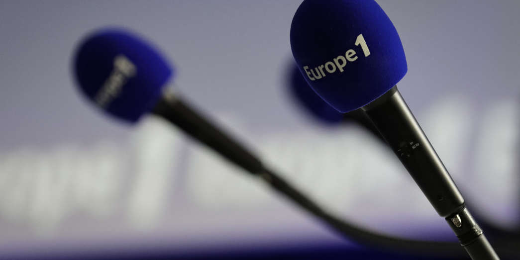 A picture taken on December 20, 2018 shows microphones with the Europe 1 logo during the Europe 1 morning radio show