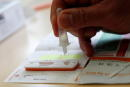 A COVID-19 self-test kit is used by school employee at Lepeltier primary school, amid the coronavirus disease (COVID-19) outbreak in La Trinite, near Nice, France, April 26, 2021. REUTERS/Eric Gaillard