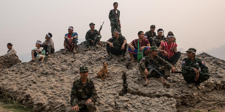 KNU soldiers guarding civilians on the Salween river bank on the protest against the Myanmar military development projects and the occupying their homeland of the KNU control area.