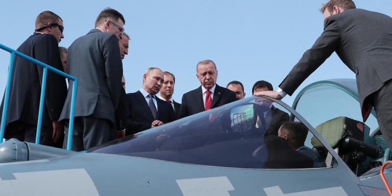 A handout picture taken and released on August 27, 2019, by the Turkish Presidential Press service, shows Russian President Vladimir Putin (C-L) and his Turkish counterpart Recep Tayyip Erdogan (C-R) inspecting a Sukhoi Su-57 fifth-generation jet fighter aircraft during the MAKS 2019 International Aviation and Space Salon opening ceremony in Zhukovsky, outside Moscow. - Russian President Vladimir Putin and Turkish leader Recep Tayyip Erdogan met for talks in Moscow on August 27 as they seek common ground on the deadly fighting in northwestern Syria. The meeting came ahead of a September 16 summit in Ankara that will bring together the main foreign players in Syria's conflict -- Putin, Erdogan and Iran's President Hassan Rouhani. (Photo by Handout / TURKISH PRESIDENCY PRESS OFFICE / AFP) / RESTRICTED TO EDITORIAL USE - MANDATORY CREDIT