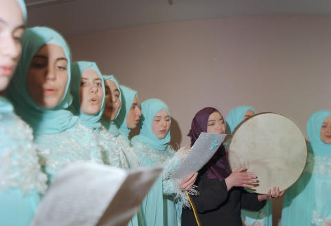 Girls perform religious songs together at the end of the year during a graduation party organized for the students who have completely memorized the holy Quran which takes some years to complete the task. For the graduation party girls are having special sewn dresses, scarves and special costumes for performing theatre for specific ancient roles in the Islamic history or some moral tales. That day all the female family members and non-graduates students are invited to watch the show. The salon is wide enough for 600-person capacity. All come to celebrate their daughters becoming hafizes. To be hafiz means those who memorize the holy Quran and who have guarded it after the prophet Muhammed almost for 500 years. According to the belief Hafızes has special light which requires special reverence and tribute in social life, and will be rewarded with a higher status in paradise. Istanbul-Turkey, June, 2017