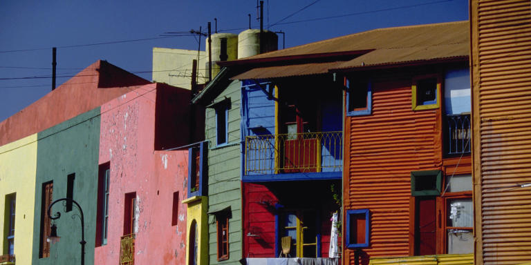 The working-class neighborhood of La Boca, on Buenos Aires' waterfront, is notable for its brightly colored buildings. GettyImages-519970534