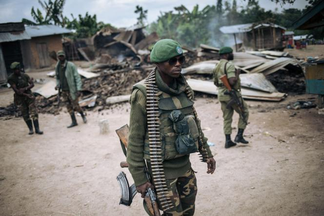 Soldiers from the Democratic Republic of the Congo patrol the village of Mansalaho near Beni on February 18, 2020.