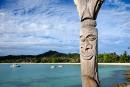 A traditional totem pole is seen in Kuto Bay on the Iles Des Pins or Isle of Pines, on the southern archipelago of the French Pacific territory of New Caledonia on May 17, 2021. / AFP / Theo Rouby