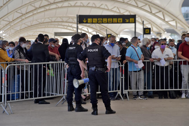 Passengers wait to board a repatriation flight from Algiers to France on May 27, 2020.