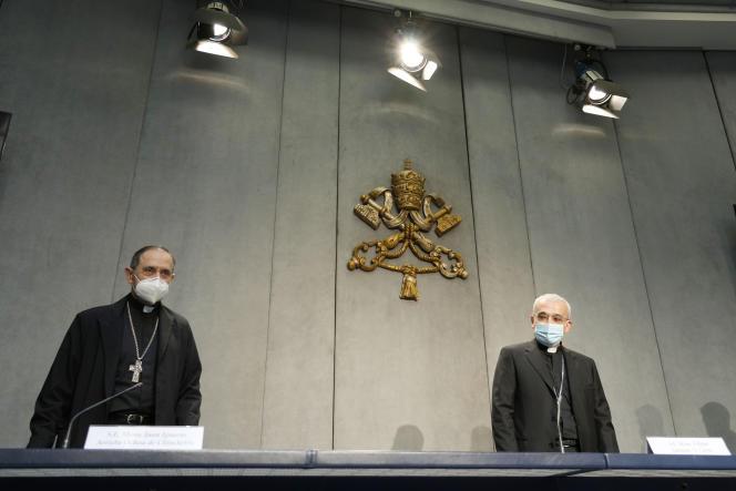 Bishop Filippo Ionon (right) and Bishop Juan Ignacio Arietta Ochoa de Cincetro present changes in the canon law of the Church during a press conference in the Vatican on Tuesday, June 1, 2021.