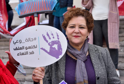 A protester holds a placard that says With a state of awareness of violence against women during the demonstration. Revive the activities of the International Women's Day corresponding to March 8, and in order to push the Tunisian state to ratify the International Labor Organization Convention No. 190 to eliminate violence at workplaces for a space free of harassment and violence against women. (Photo by Jdidi Wassim / SOPA Images/Sipa USA)No Use Germany.