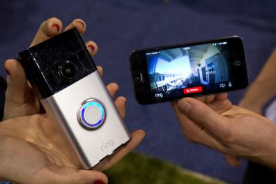 FILE PHOTO: A Ring video doorbell (L) is displayed during the 2015 International Consumer Electronics Show (CES) in Las Vegas, Nevada January 7, 2015. The doorbell connects with home Wi-Fi to send a video call to the homeowner's smartphone. REUTERS/Steve Marcus/File Photo