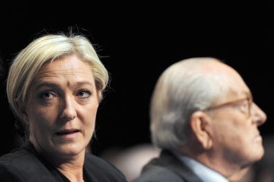 Newly elected president of French far-right party Front national (National Front), Marine Le Pen (L) and former president Jean-Marie Le Pen attend the party's congress, on January 16, 2011 in Tours, western France. The 42-year-old FN vice-president Marine Le Pen (67.5%) beats his rival Bruno Gollnisch (32.35%) in the vote conducted among the grouping's 24,000-odd members. AFP PHOTO ALAIN JOCARD (Photo by ALAIN JOCARD / AFP)