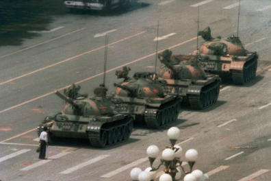 FILE - In this June 5, 1989, file photo, a man stands alone in front of a line of tanks heading east on Beijing's Changan Blvd. in Tiananmen Square, Beijing. Hong Kong's second ban on an annual vigil for victims of the bloody June 4, 1989, crackdown on Beijing's Tiananmen Square protest movement and the closure of a museum dedicated to the event may be a further sign that the ruling Communist Party is extending its efforts to erase the event from the collective consciousness from the mainland to Hong Kong. (AP Photo/Jeff Widener, File)