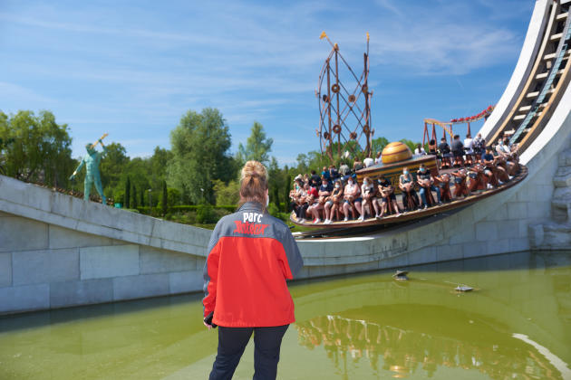An employee of Parc Astérix monitors visitors in an attraction on June 9, 2021, the day of the reopening.