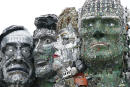 A sculpture created out of e-waste in the likeness of Mount Rushmore and the G7 leaders stands on a hill in Hayle, Cornwall, England, Wednesday, June 9, 2021. The sculpture, created by British artist Joe Rush ad sculptor Alex Wreckage, named Mount Recyclemore, aims to highlight the growing threat of e-waste. G7 leaders and guests will meet in the the Cornish resort of Carbis Bay starting Friday, June 11, 2021. (AP Photo/Jon Super)