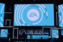 """(FILES) In this file photo Electronic Arts (EA) Executive Vice President Patrick Soderlund speaks at the Microsoft Xbox E3 2017 Briefing, June 11, 2017 at the Galen Center in Los Angeles, California. Electronic Arts said on June 10, 2021 hackers managed to steal source code and other software tools from the video game giant, but that the attack was unlikely to have an impact on gamers or business operations. EA, the maker of popular titles such as """"Battlefield,"""" acknowledged the breach after a report by Vice Media that attackers had made off with the code used for games including FIFA 21 and the Frostbite engine, which powers some EA games. / AFP / Robyn BECK"""