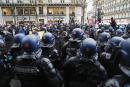 Riot mobile gendarmes (down) stands between police officers (R) and protestors (L) during a demonstration in Paris on December 12, 2020, against the 'global security' draft law. - It is the third weekend of demonstrations in France during protests against a security bill currently going through French parliament, that would restrict publication of pictures showing the faces of police. (Photo by GEOFFROY VAN DER HASSELT / AFP)