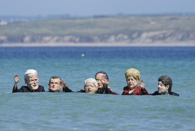Activists protest against the inaction of heads of state and government in the face of global warming at the G7 in St Ives on June 13, 2021.