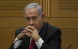 Former Israeli Prime Minister Benjamin Netanyahu speaks to right-wing opposition party members a day after a new government was sworn in, at the Knesset, Israel's parliament, in Jerusalem, Monday, June 14, 2021. (AP Photo/Maya Alleruzzo)